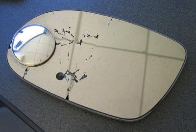 Broken, detached rearview mirror