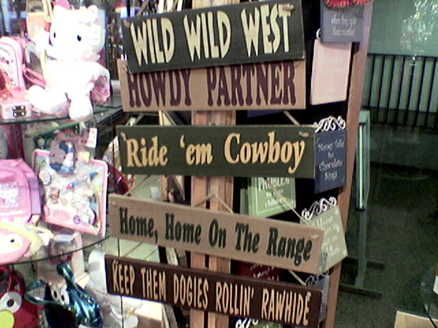 SIlly signs in airport gift shop