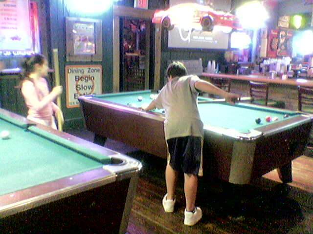 Molly and Jake play pool